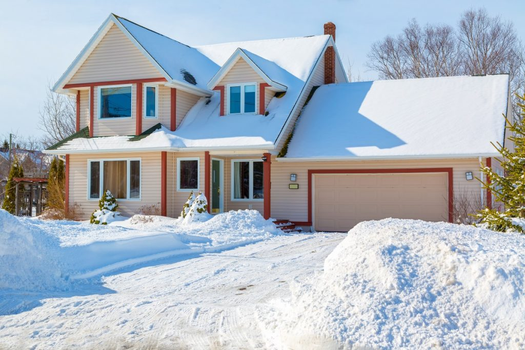 American home covered in snow