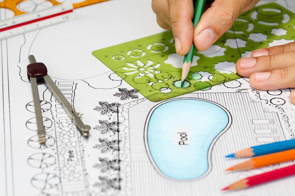 landscape artist drawing a landscape design