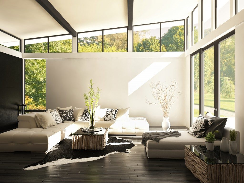 modern living room surrounded by glass windows