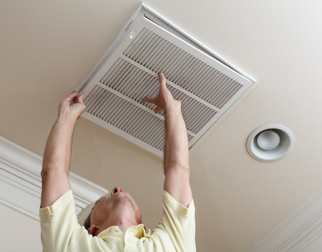 man installing an air filter