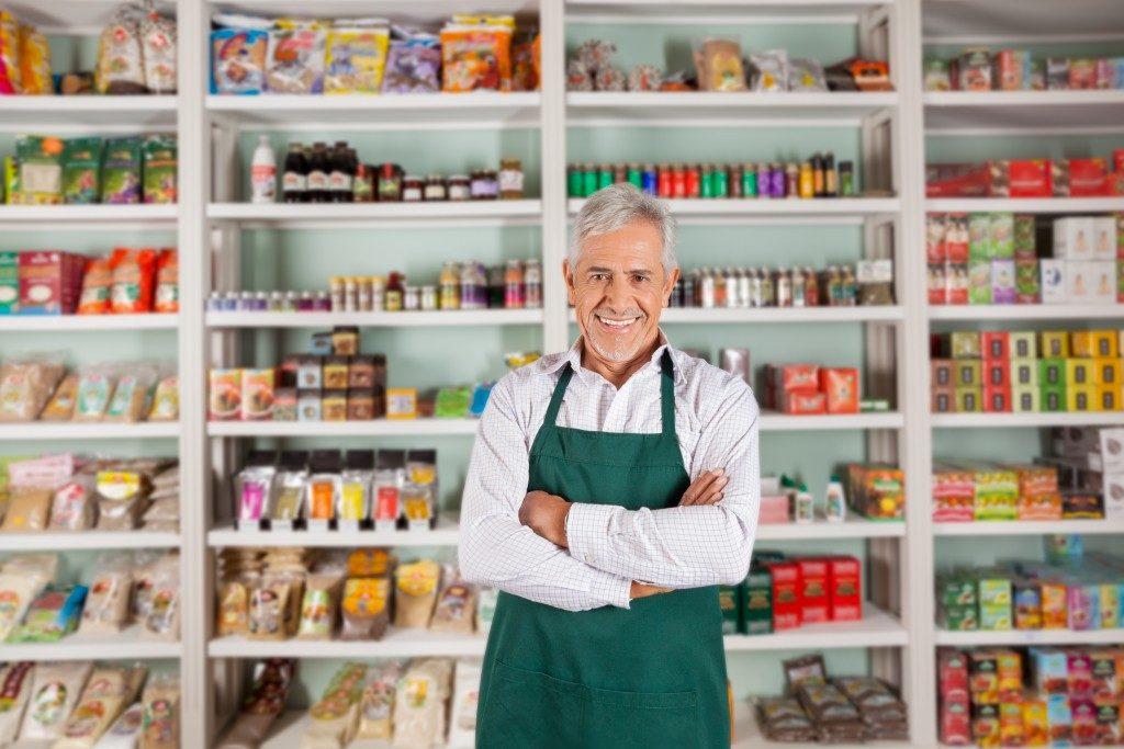portrait of a man inside his supermarket