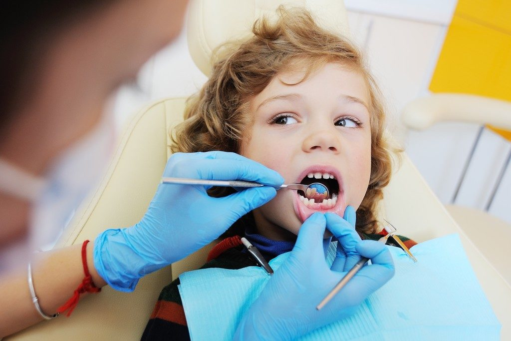 child at the dental clinic getting his chek-up