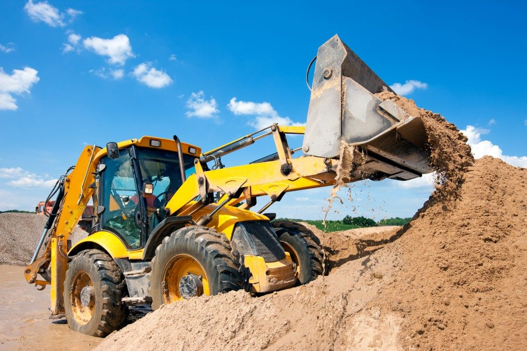 heavy equipment digging dirt