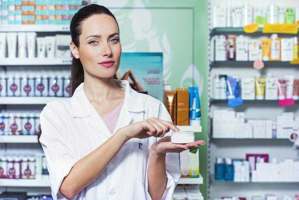 woman holding a medicine