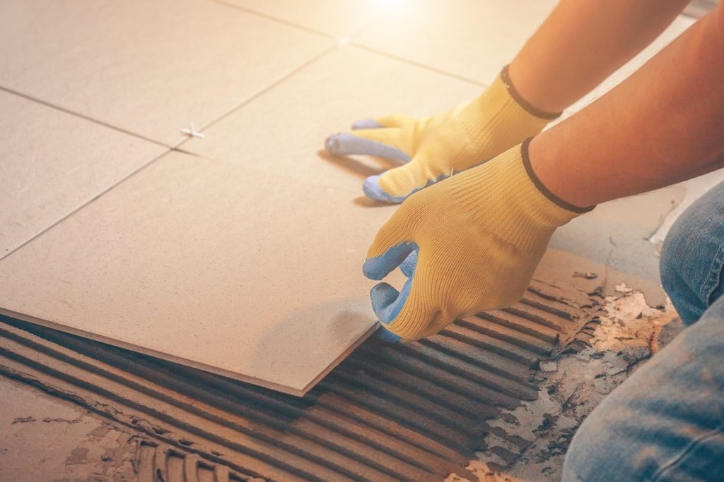 Tiles being placed on cement