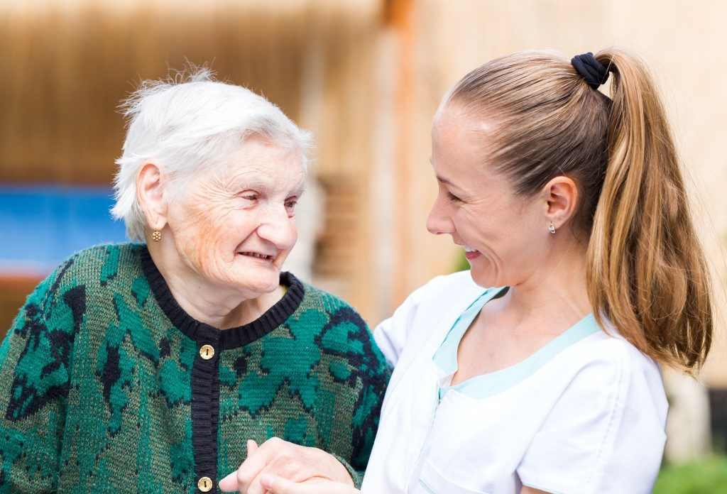 nurse assisting a senior