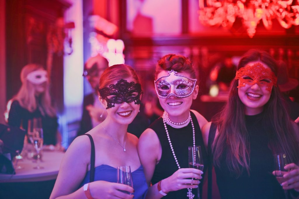people wearing mask in a party