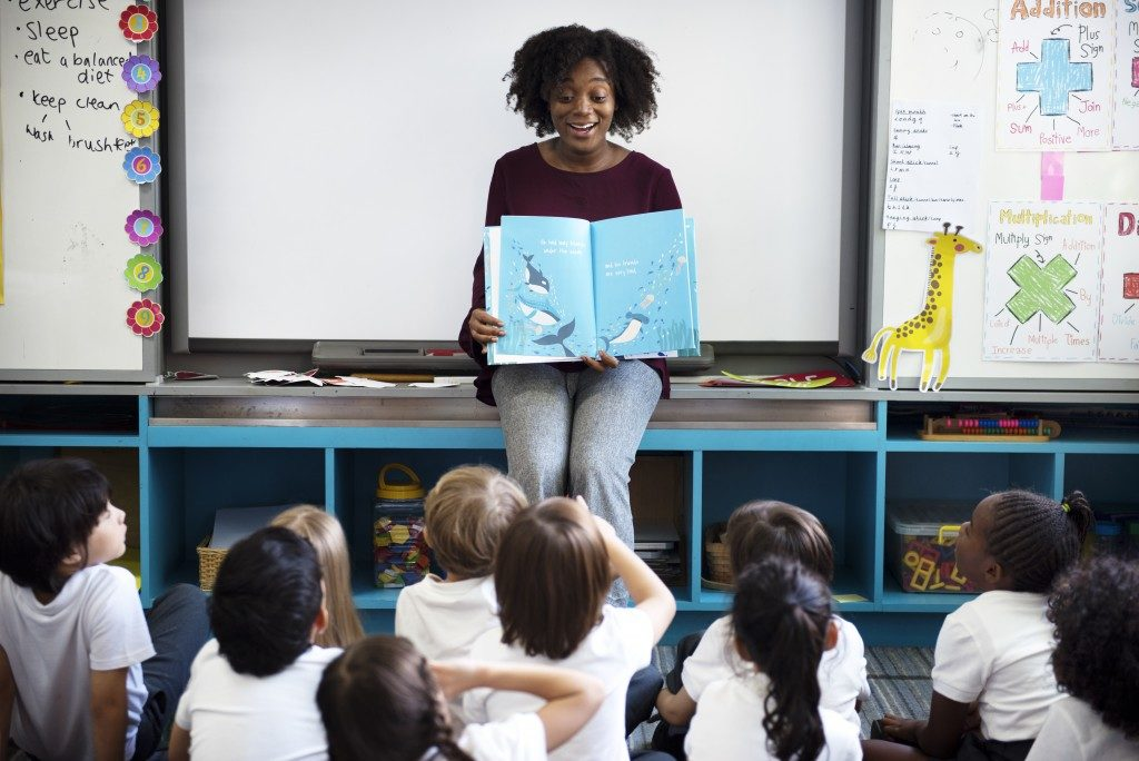 reading a story to young students