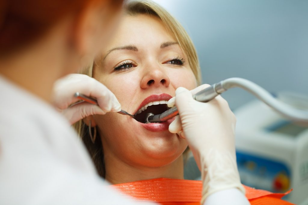 woman consulting a dentist