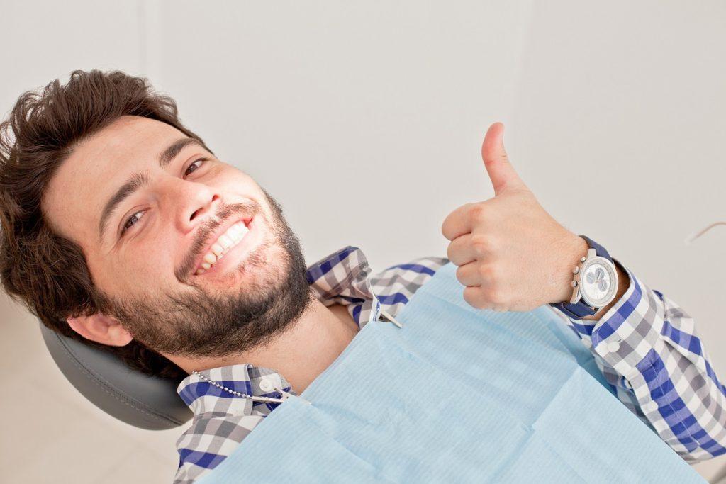 man smiling at dental clinic