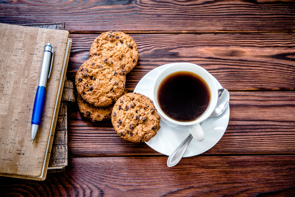 coffee, notebook and cookies