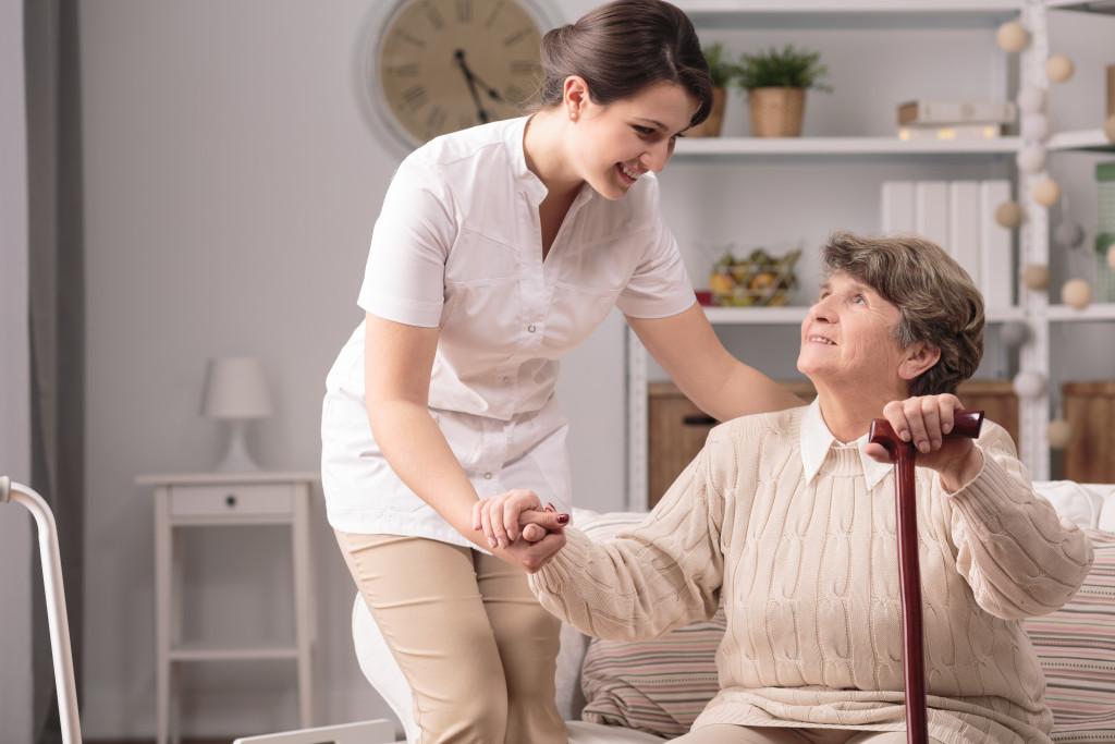 nurse taking care of older lady