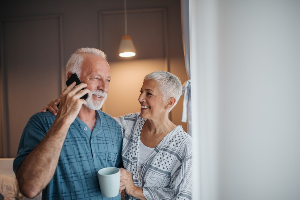 senior couple on the phone