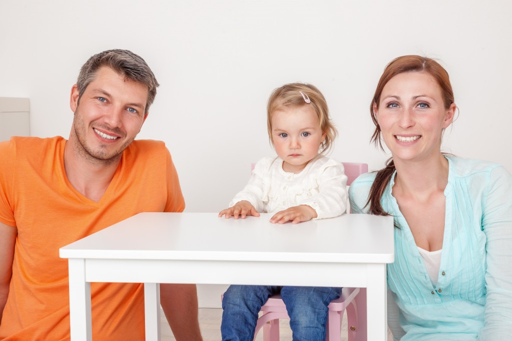mom and dad with daughter