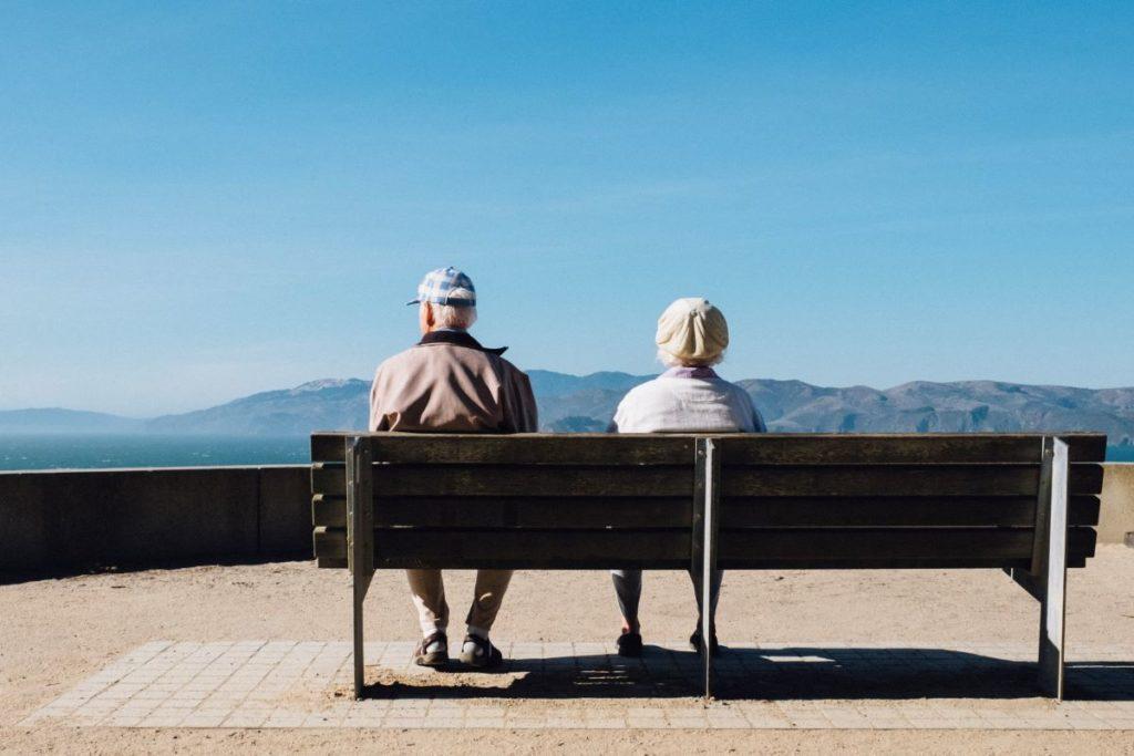 elder couple sitting on bench