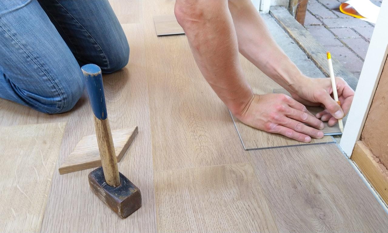 man fixing the flooring