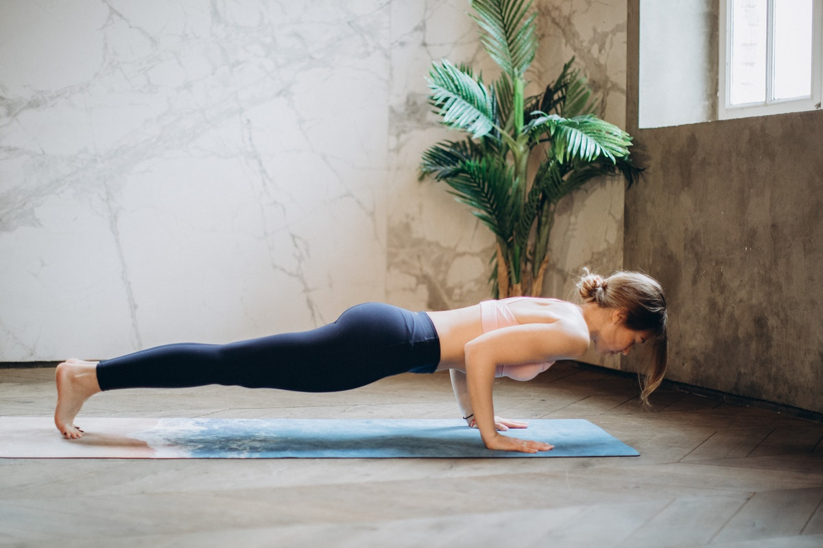 woman planking stretching exercise