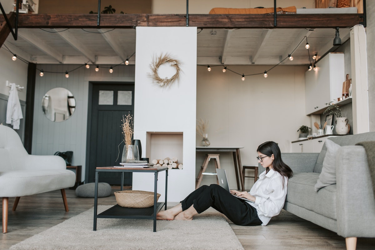 woman working from home on the floor