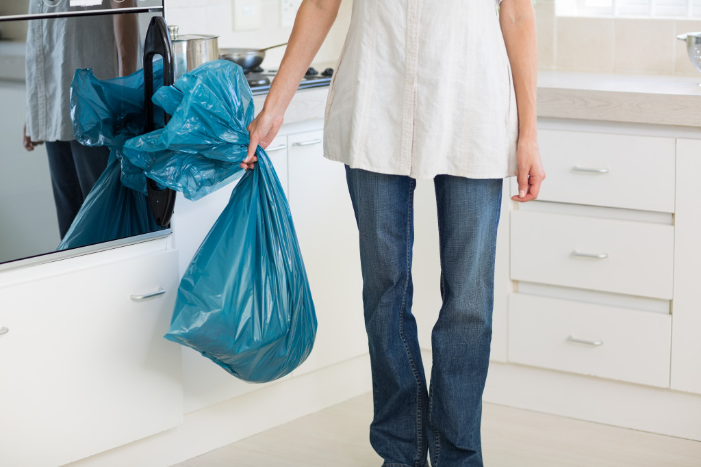 woman holding a garbage bag