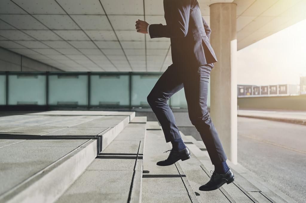 man walking up career steps