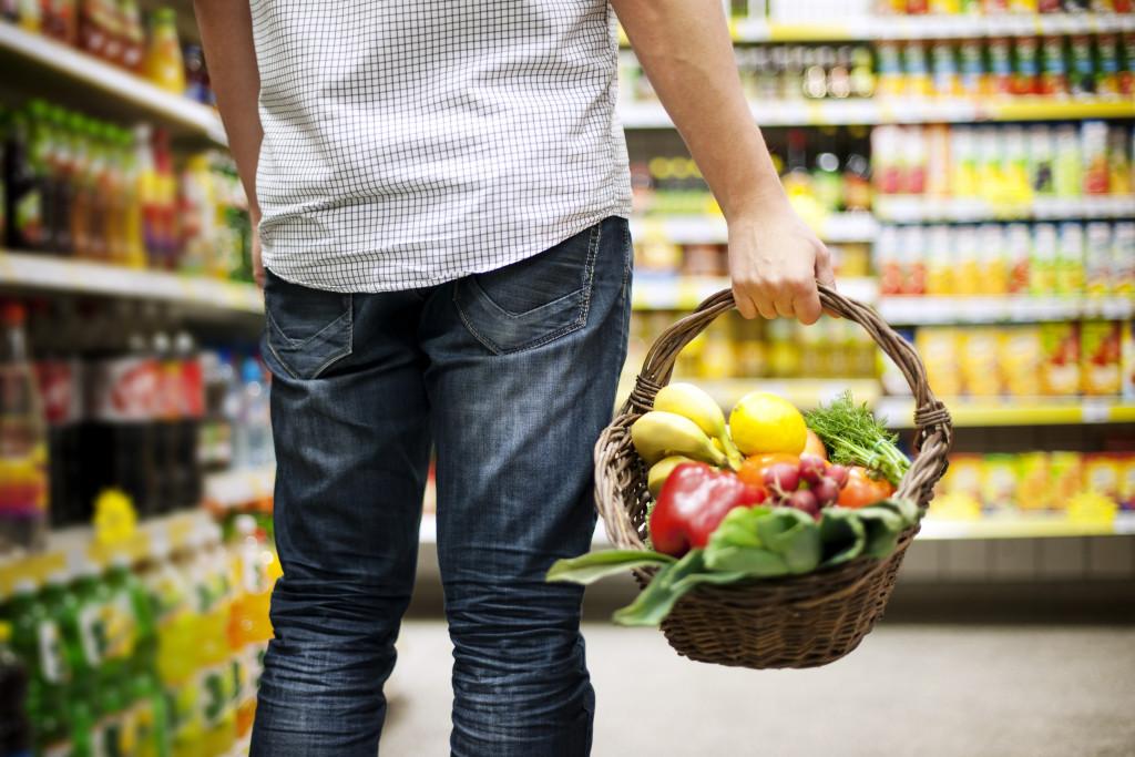 man holding basket of food